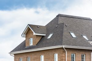 roof of big brick house Evergreen Construction Solutions 8425 Old Statesville Rd #8, Charlotte, NC 28269 (704) 609-3561