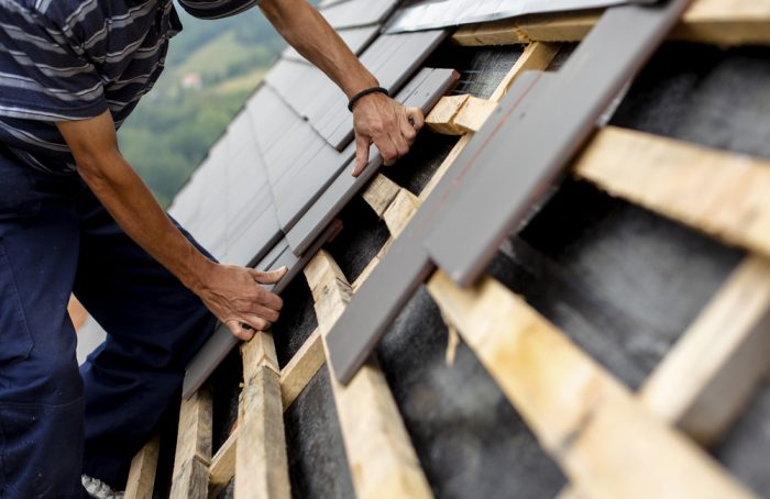 guy installing roof Evergreen Construction Solutions 8425 Old Statesville Rd #8, Charlotte, NC 28269 (704) 609-3561