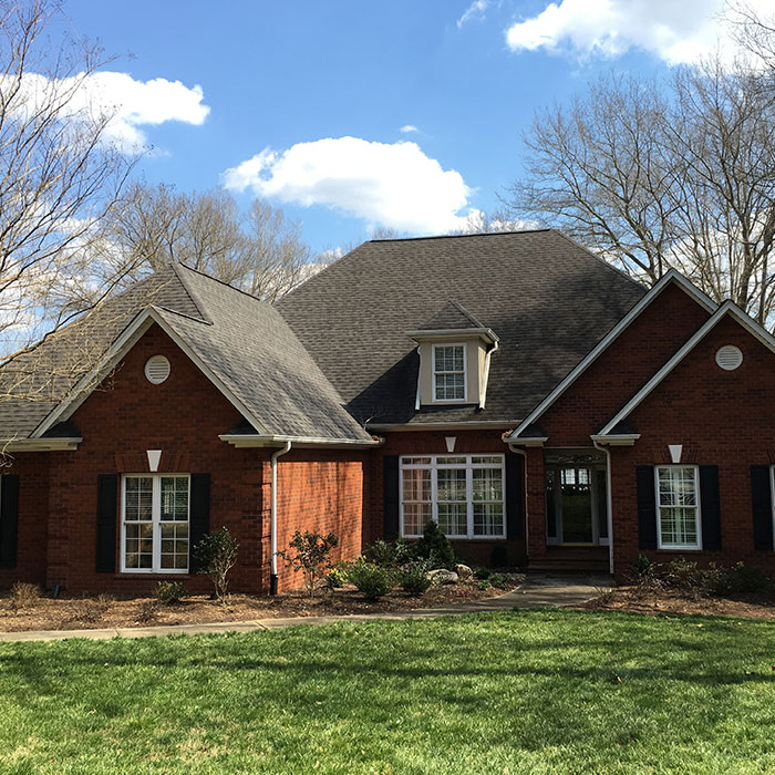 front view of brick house Evergreen Construction Solutions 8425 Old Statesville Rd #8, Charlotte, NC 28269 (704) 609-3561