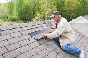 guy replacing shingles Evergreen Construction Solutions 8425 Old Statesville Rd #8, Charlotte, NC 28269 (704) 609-3561
