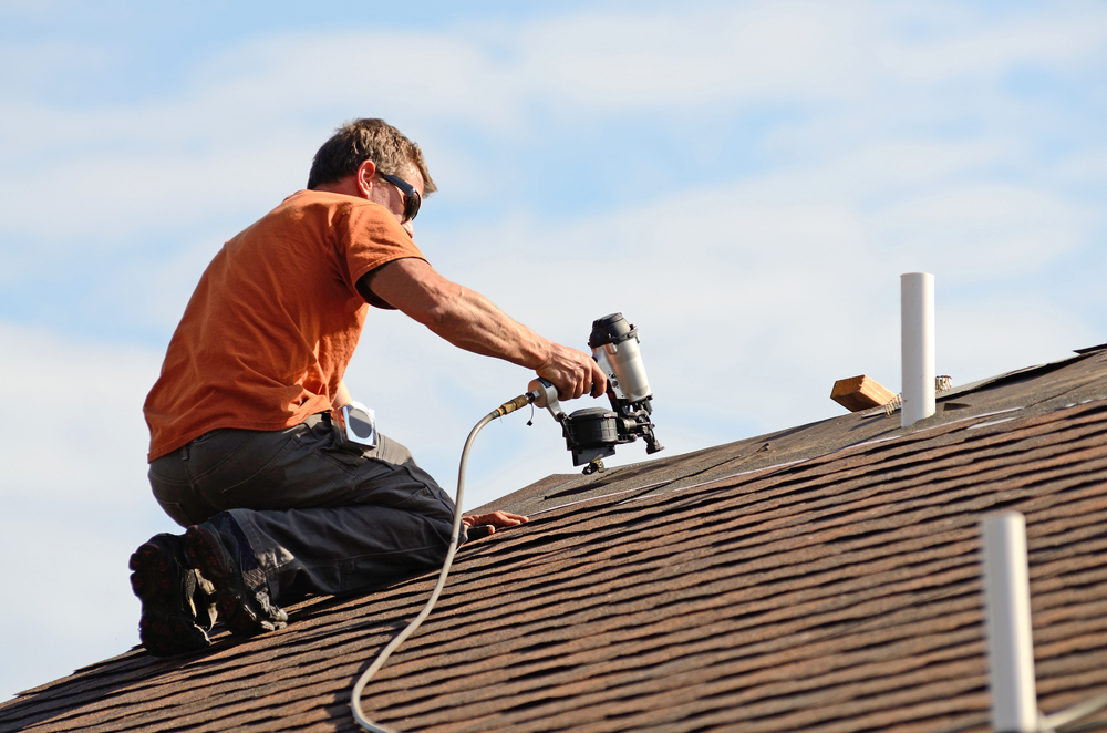 man nailing on shingles Evergreen Construction Solutions 8425 Old Statesville Rd #8, Charlotte, NC 28269 (704) 609-3561