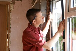 guy replacing window Evergreen Construction Solutions 8425 Old Statesville Rd #8, Charlotte, NC 28269 (704) 609-3561